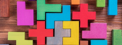 Image of coloured wooden puzzle pieces